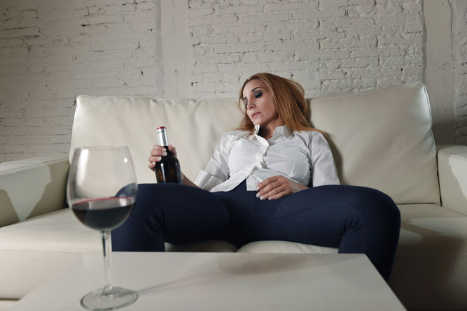 alcoholic woman laying on couch